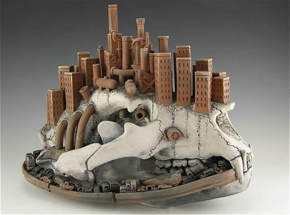 Sculpture of buildings on top of a skull.